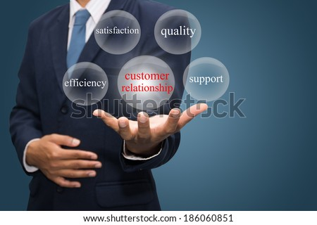 businessman hand write a customer relationship - stock photo