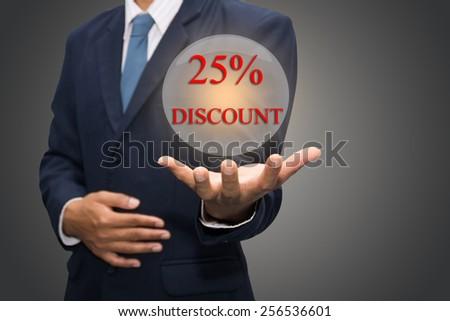 Businessman hand write a 25% DISCOUNT - stock photo