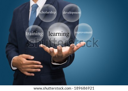 businessman hand write a learning  - stock photo
