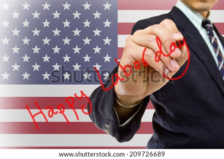 Businessman hand write Happy labor day with USA Flag