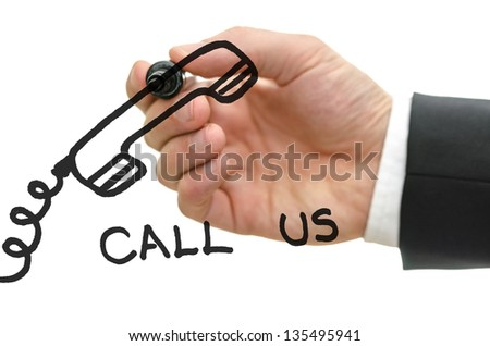 Businessman hand writing a call us message with a drawing of phone on a glass board. Over white background. - stock photo