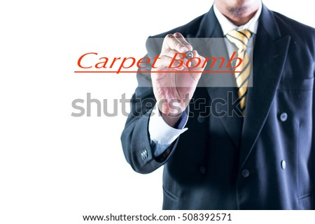 Businessman hand writing Carpet Bomb on transparent wipe board.