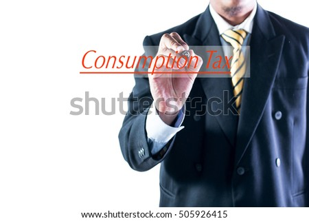 Businessman hand writing Consumption Tax on transparent wipe board.