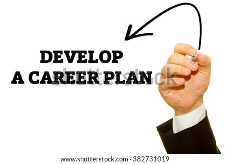 Businessman hand writing Develop A Career Plan on a transparent wipe board. - stock photo
