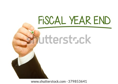 Businessman hand writing Fiscal Year End on a transparent wipe board.