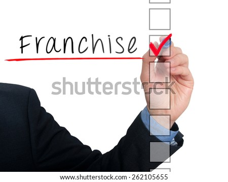 Businessman hand writing Franchise and check listing task. Isolated on white background. Stock photo - stock photo