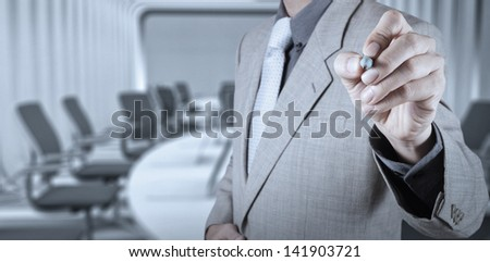 businessman hand writing in the whiteboard or virtual screen - stock photo