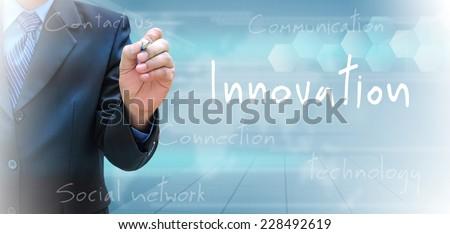 businessman hand writing innovation  - stock photo