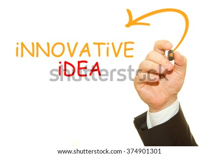 Businessman hand writing innovative idea with a marker on a transparent wipe board - stock photo