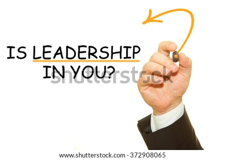 Businessman hand writing is Leadership in you on a transparent wipe board - stock photo