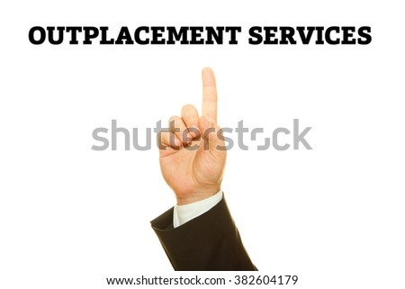 Businessman Hand writing Outplacement Services on a transparent wipe board. - stock photo