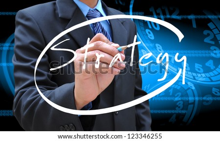 businessman hand writing strategy