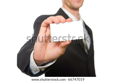 Businessman handing a blank business card over white - stock photo