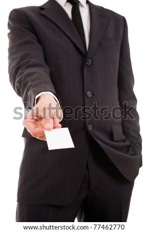 Businessman handing a blank business card over white background - stock photo