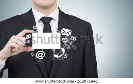 Businessman handing a business card with email symbol - stock photo