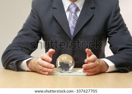 Businessman handing a dollar sign - stock photo
