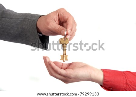 Businessman handing a key to success over a woman palm. - stock photo