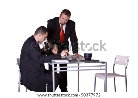 Businessman Handing a Pen to Another to Sign a Contract - stock photo