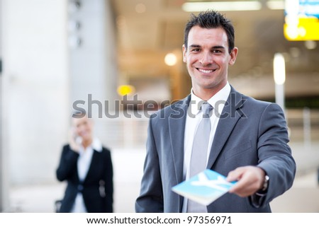 businessman handing over air ticket in airport check in counter, - stock photo