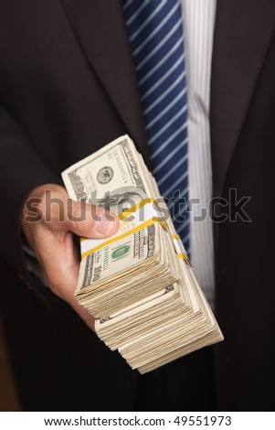 Businessman Handing Over Stack of One Hundred Dollar Bills.