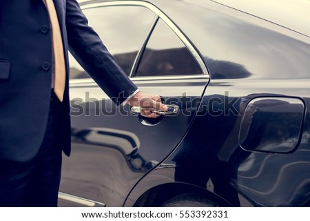 [fb] les angélus // jola&monsiame Stock-photo-businessman-handle-limousine-door-car-553392331