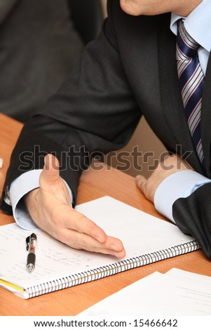 businessman hands and notepad on the table - stock photo