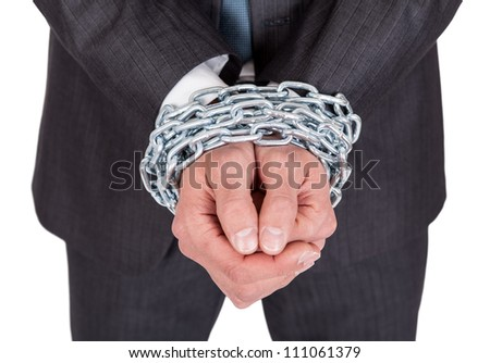 Businessman hands bound in chains. Isolated on white - stock photo