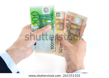 Businessman hands counting money, Euro currency (EUR) - stock photo
