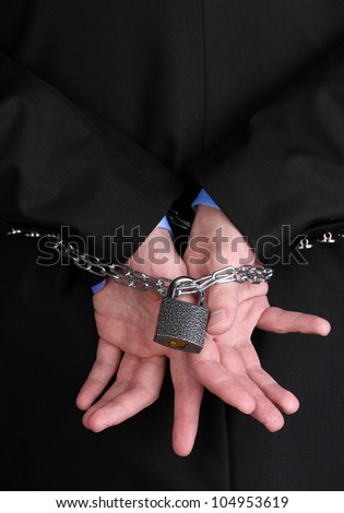 Businessman hands fettered with chain and padlock - stock photo