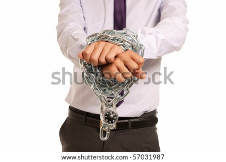 Businessman hands fettered with chain and padlock, job slave symbol, isolated on white background - stock photo