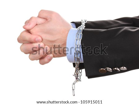 Businessman hands fettered with chain isolated on white - stock photo