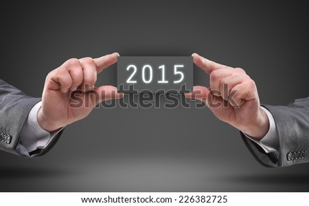 businessman hands holding object board with number 2015 High resolution  - stock photo