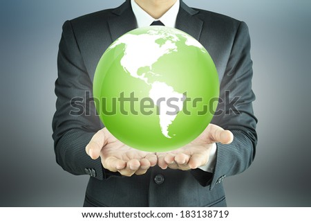 Businessman hands holding the globe  - worldwide services, rule the world,   world domination concepts etc.