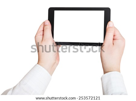 businessman hands holding touchscreen pc with cut out screen isolated on white background - stock photo