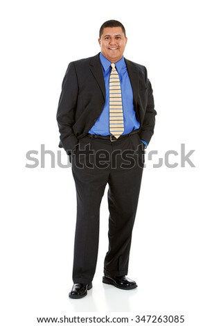 Businessman:  Hands in Pockets And Smiling At Camera