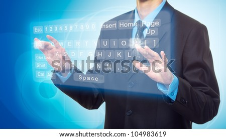 Businessman Hands pushing a button on a virtual keyboard - stock photo
