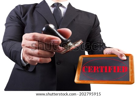 businessman hands put the stamp wood blackboard red certified word stamp on white background with clipping path - stock photo