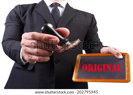businessman hands put the stamp wood blackboard red original word stamp on white background with clipping path - stock photo