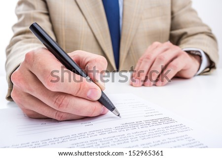 Businessman hands signing a contract. - stock photo