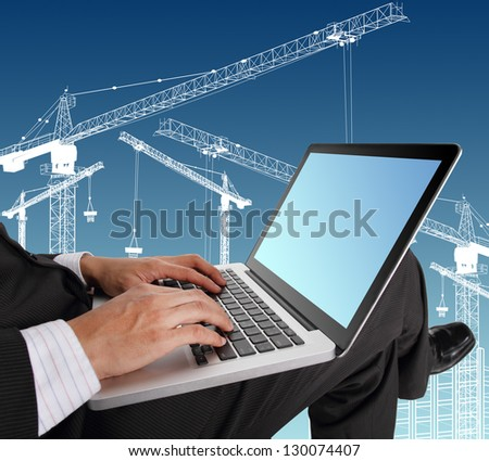 Businessman hands typing on laptop keyboard  with crane illustration background