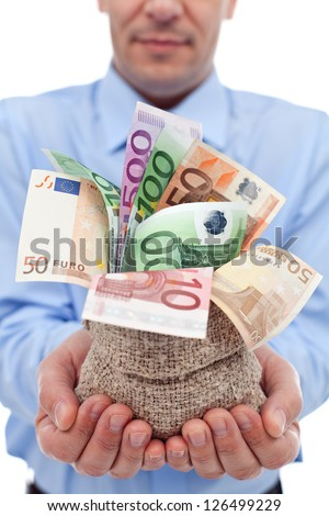 Businessman hands with euro banknotes in a money bag - closeup - stock photo