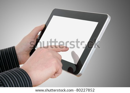 businessman hands with touch pad on grey background - stock photo