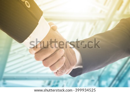 Businessman handshake for agreement with partnership to agree their business. - stock photo