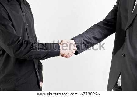 Businessman handshake isolated on white, in suits