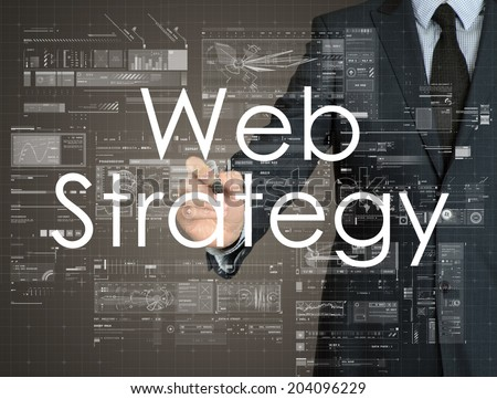 businessman handwriting Web Strategy on a transparent board - stock photo