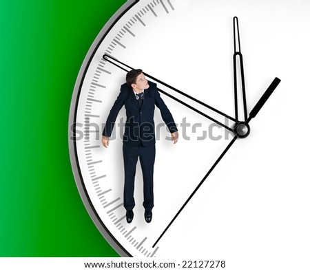 Businessman hangs on an arrow of clock, isolated on green background - stock photo