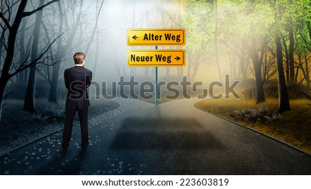 businessman has to decide between the two options old way and new way (in German) - stock photo