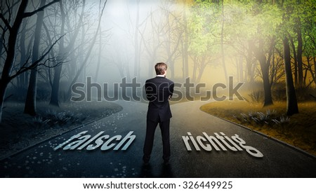 "businessman has to decide which direction is better with the words ""wrong"" and ""right"" on the road (in German) - stock photo"