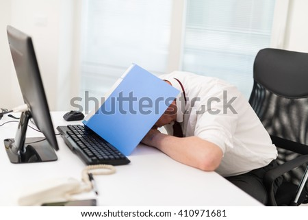 Businessman having a bad day at the office - stock photo