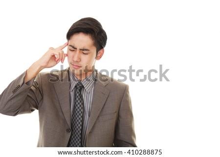 Businessman having a headache  - stock photo